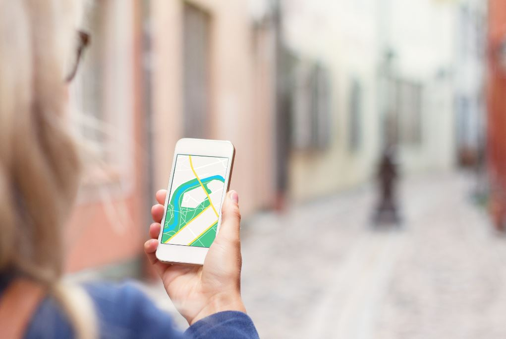 Woman navigating in a city with her mobile phone